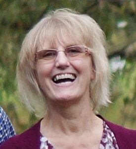 A smiling photo of Eva Hayes, ECM Board Chair
